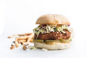SuperChix fried chicken sandwich with pickles and coleslaw.
