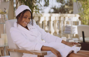 Tiffany Haddish in a chaise lounge